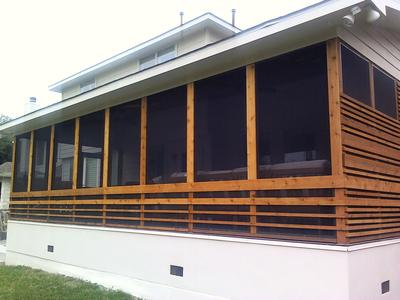Patio panels sandwiched between wood trim